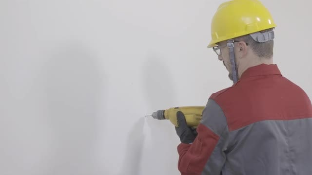 Worker Drilling A Hole In The Wall: Stock Video