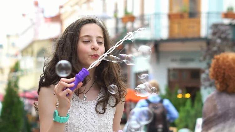 Little Girl Makes Soap Bubbles: Stock Video