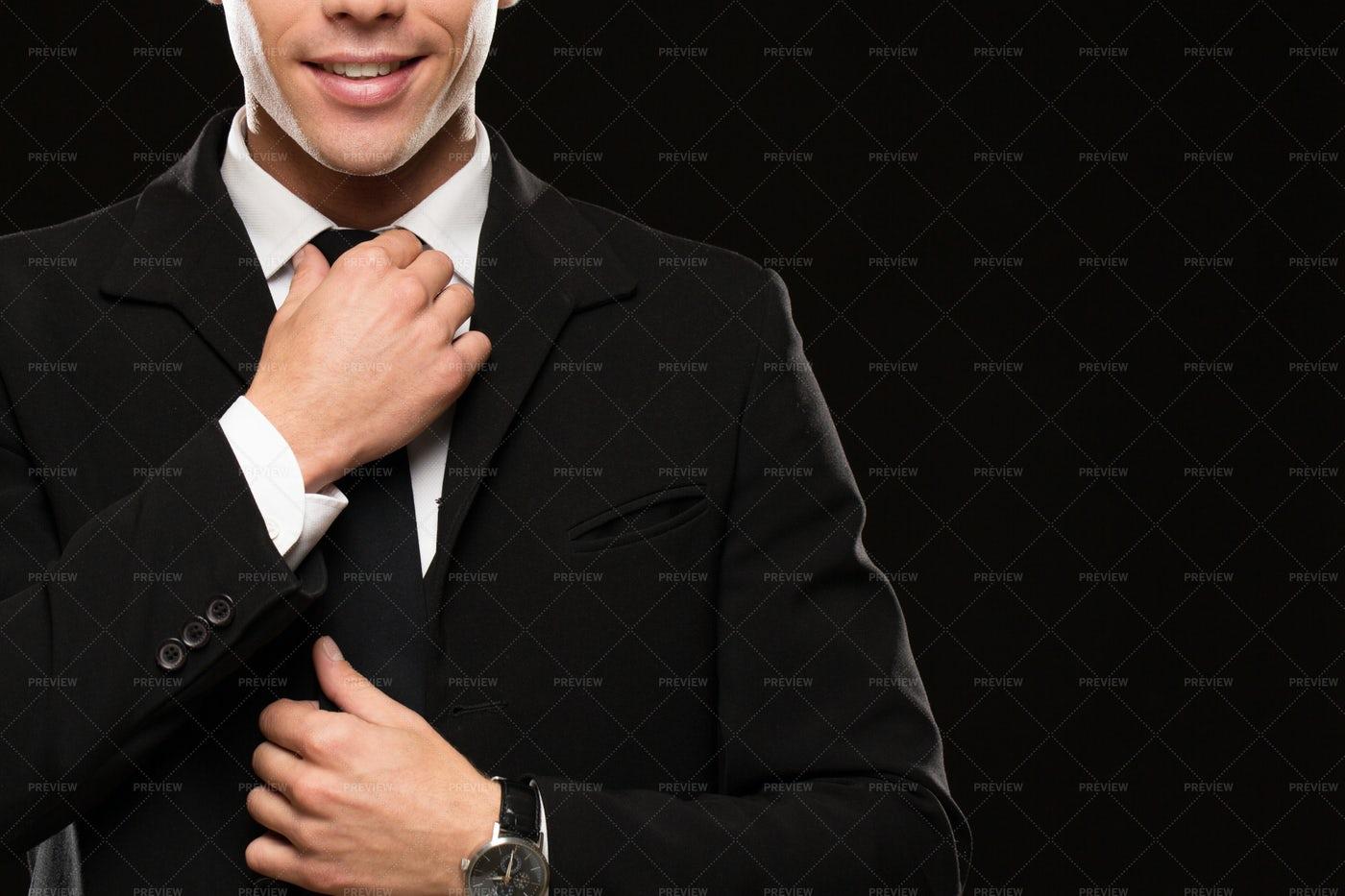 Body Guard Adjusts Tie: Stock Photos