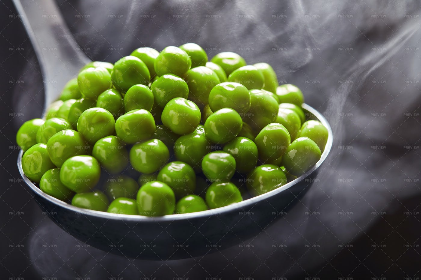 Green Peas In A Ladle: Stock Photos