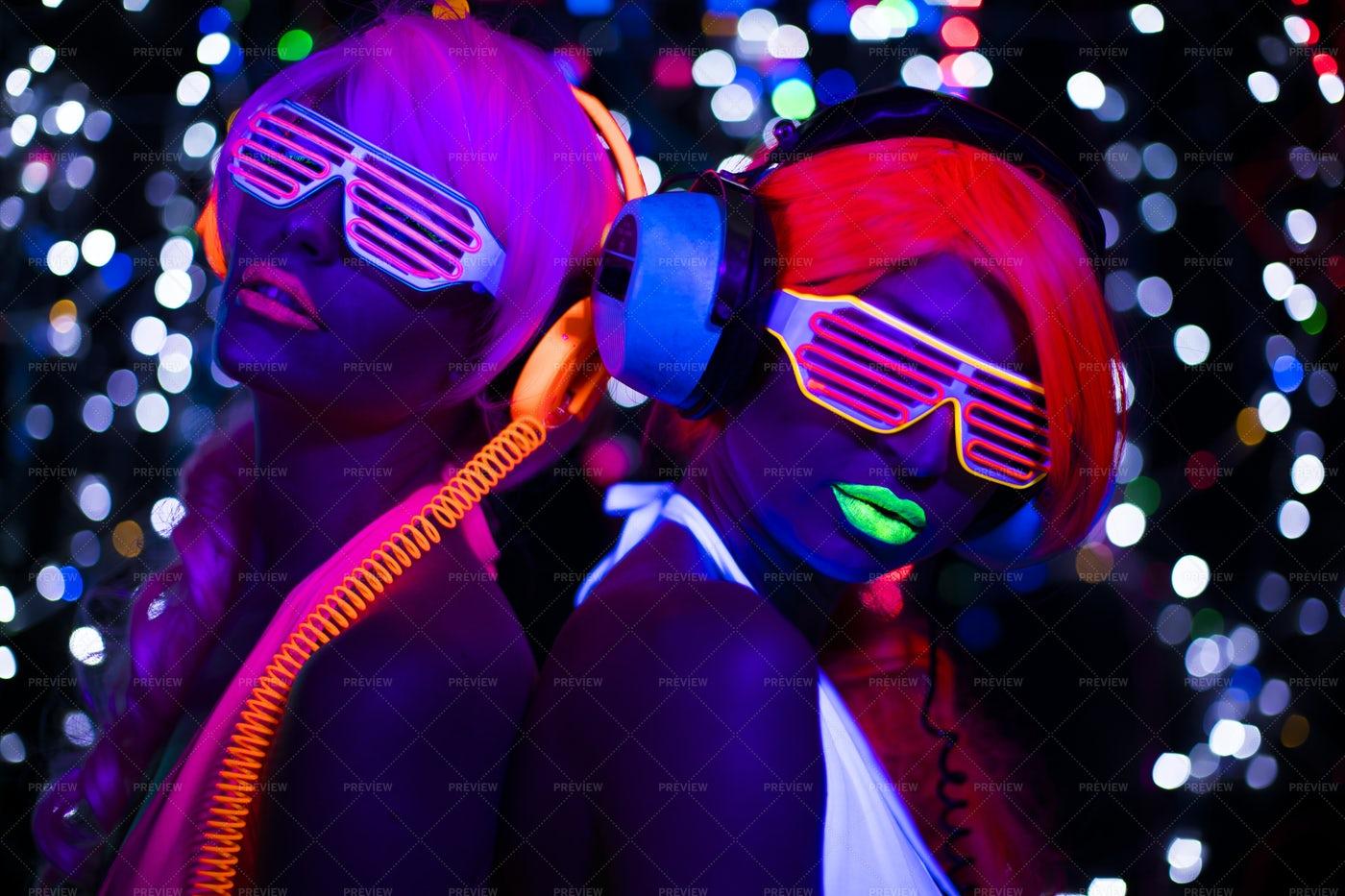 Fluorescent Disco Women: Stock Photos