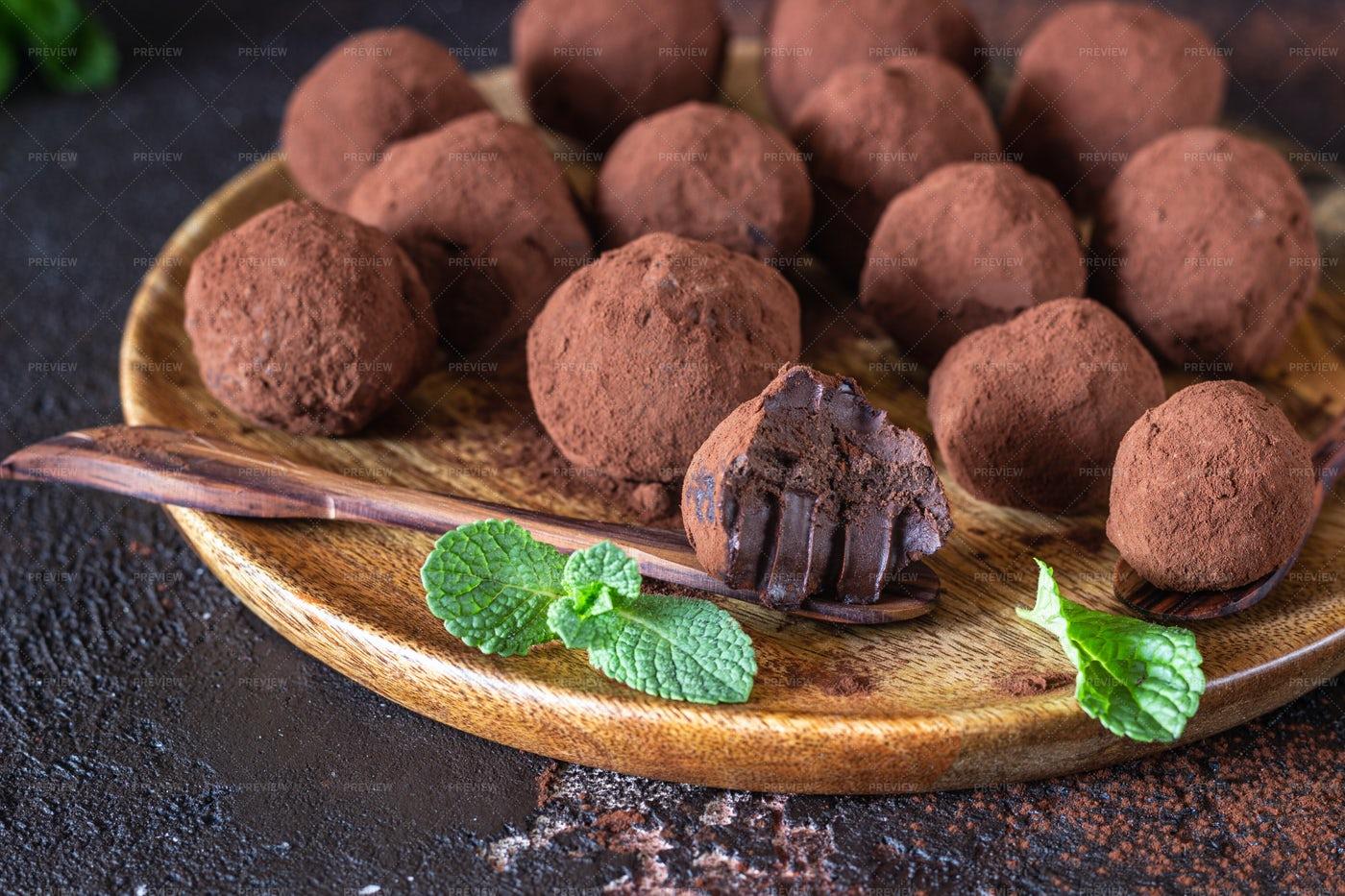 Dark Chocolate Truffles And Mint: Stock Photos
