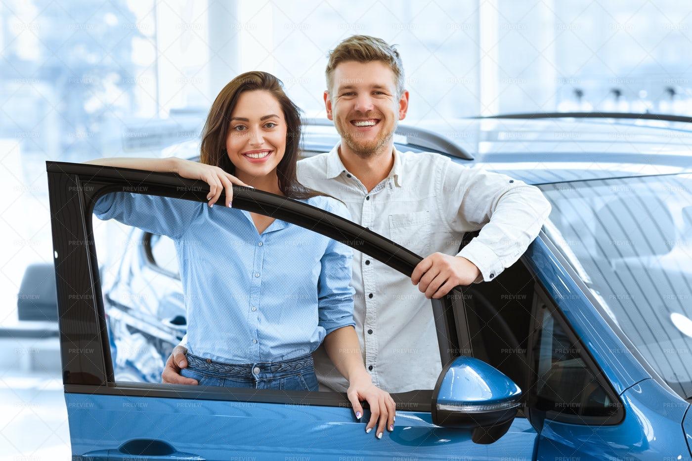 Couple At Car Salon: Stock Photos