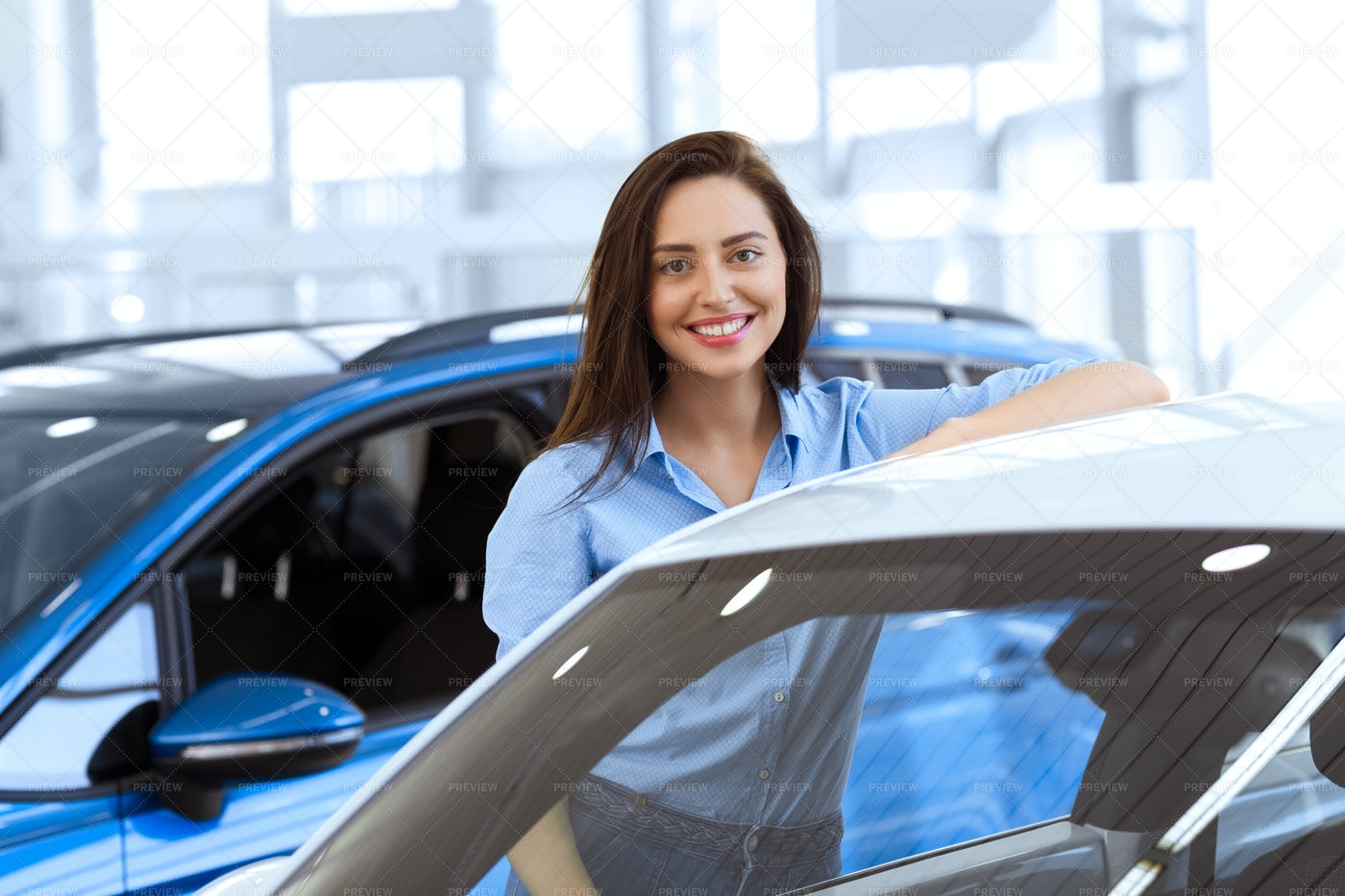 Woman Browsing New Cars: Stock Photos