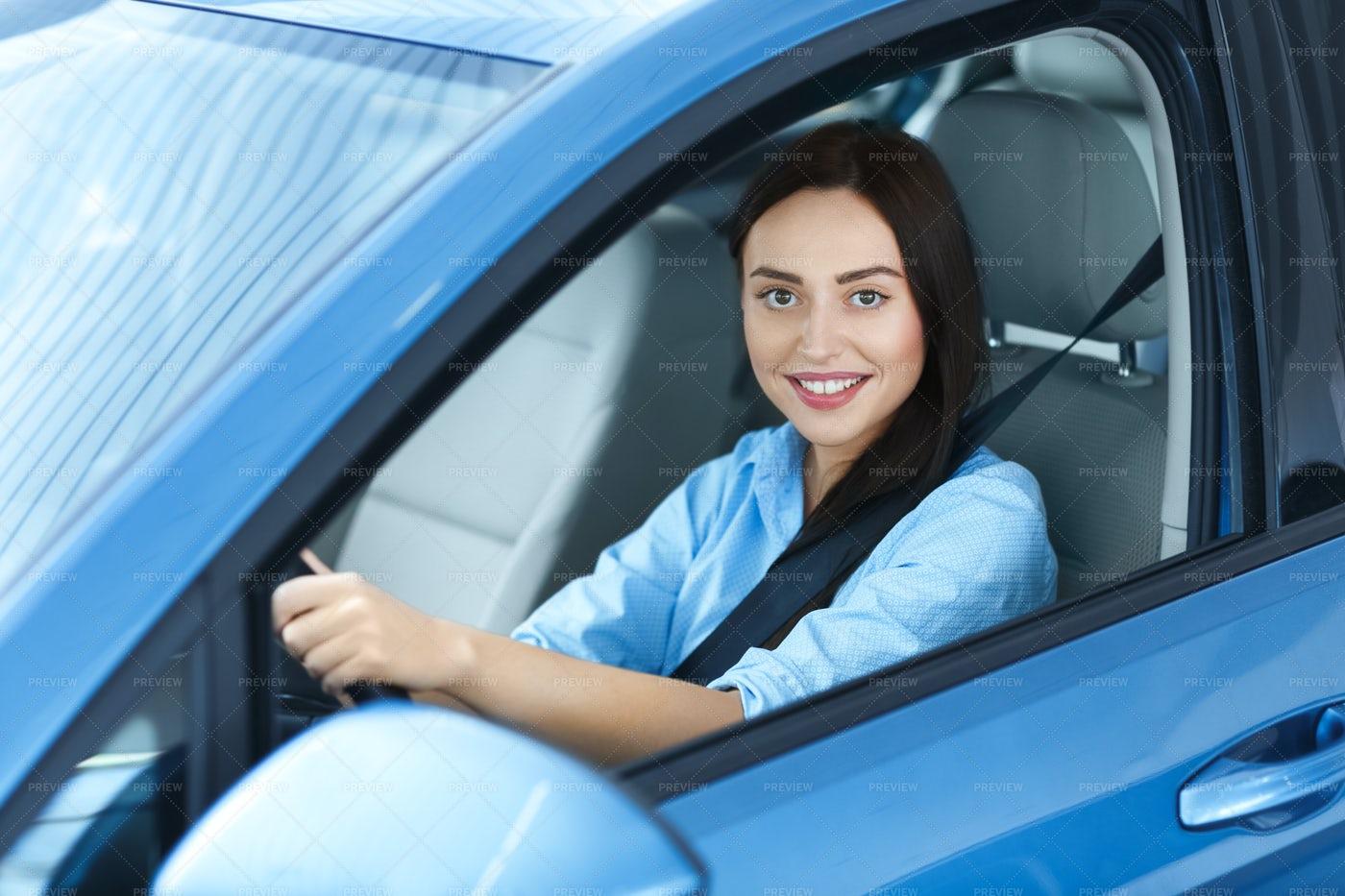 Woman Driving A New Car: Stock Photos