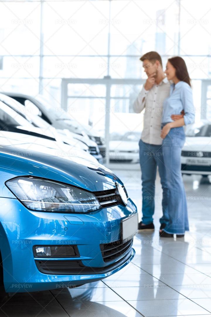 Couple Choosing A Car: Stock Photos