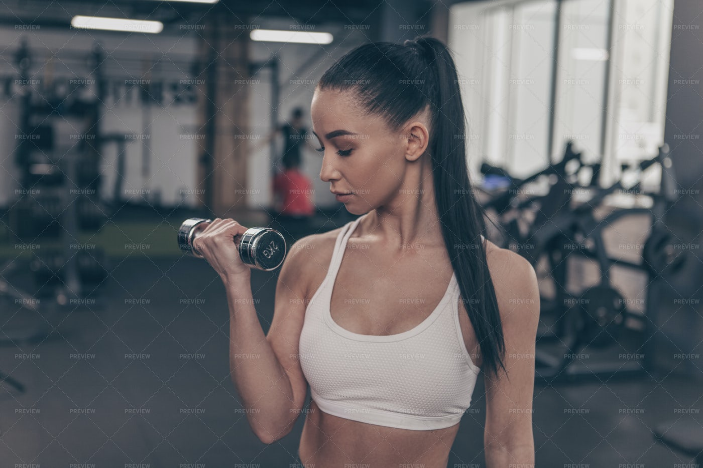 Performing Dumbbell Curls: Stock Photos