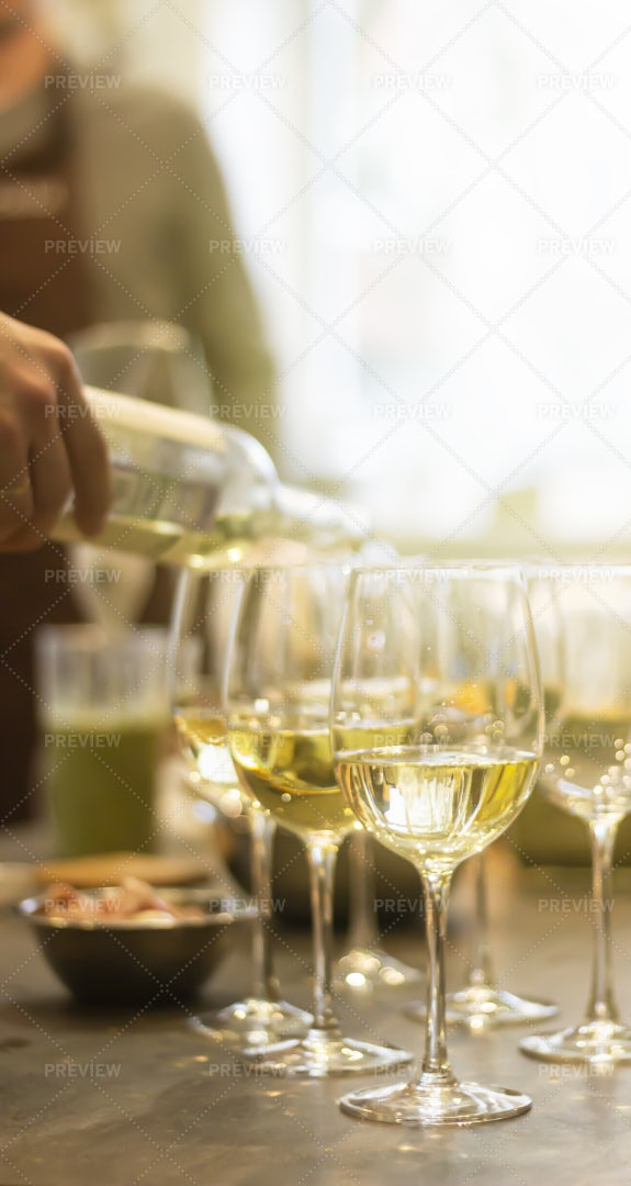 Pouring Wine Into Glasses: Stock Photos