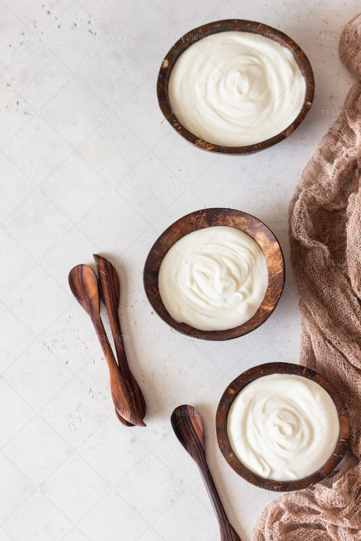 Yogurt In Coconut Bowls: Stock Photos