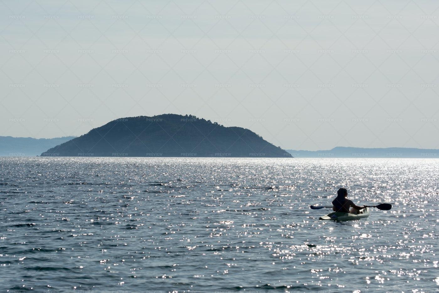 Silhouette Of Kayaking Man: Stock Photos
