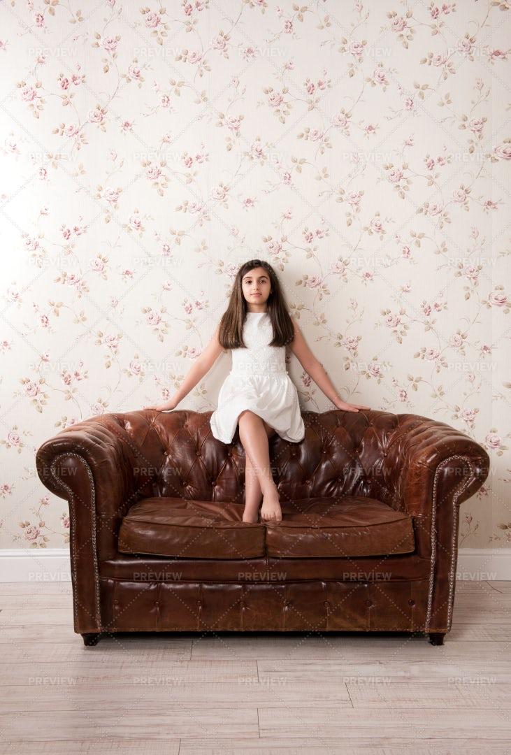 Girl On Vintage Sofa: Stock Photos