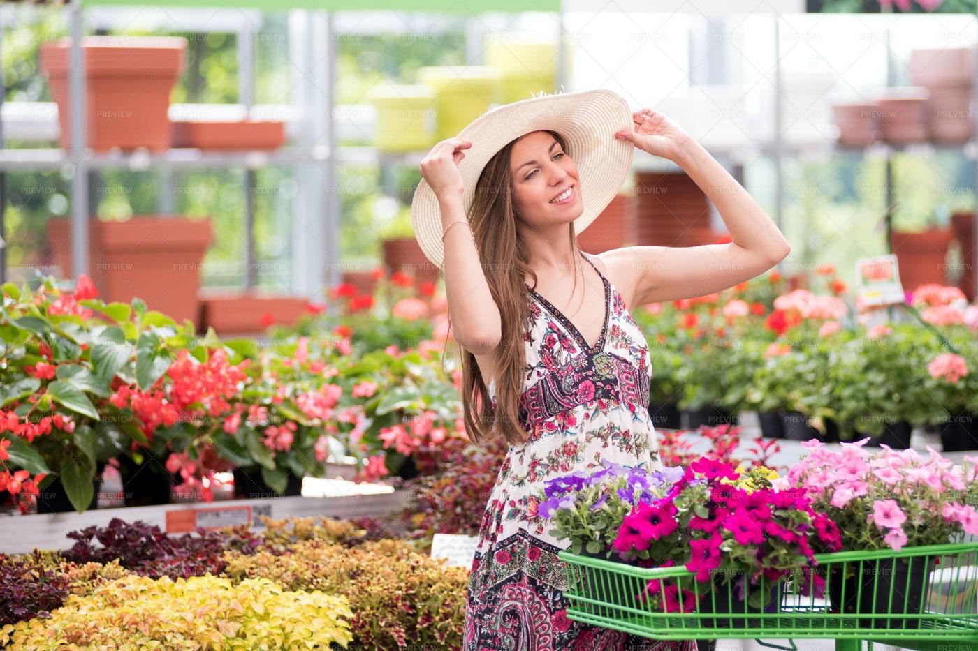 Woman Shopping In A Nursery: Stock Photos