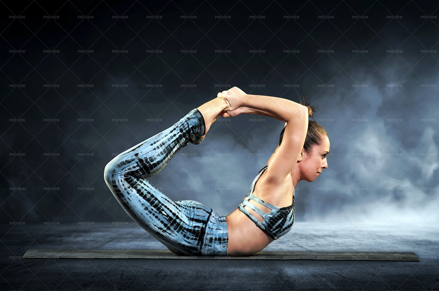 Woman Demonstrates The Bow Pose: Stock Photos