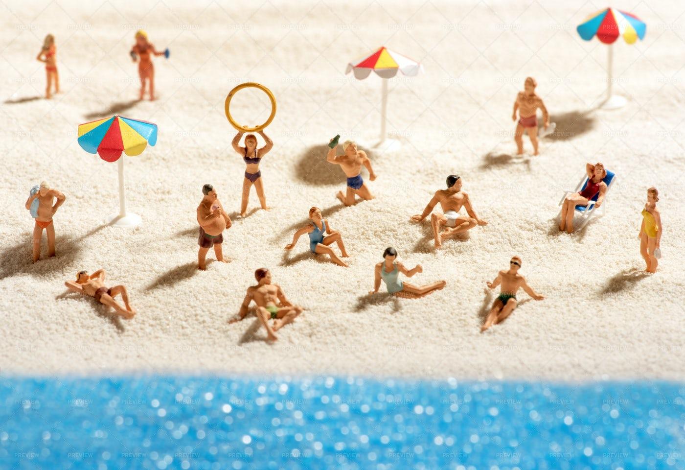 Miniature People Sunbathing: Stock Photos