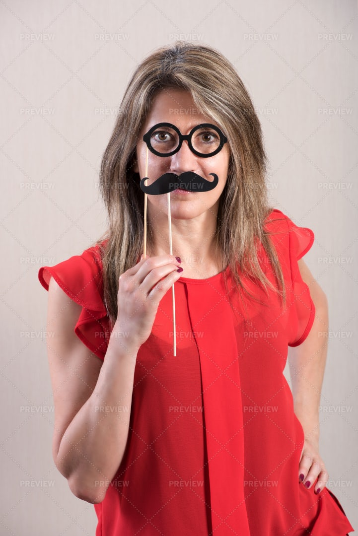 Holding Funny Mustache: Stock Photos
