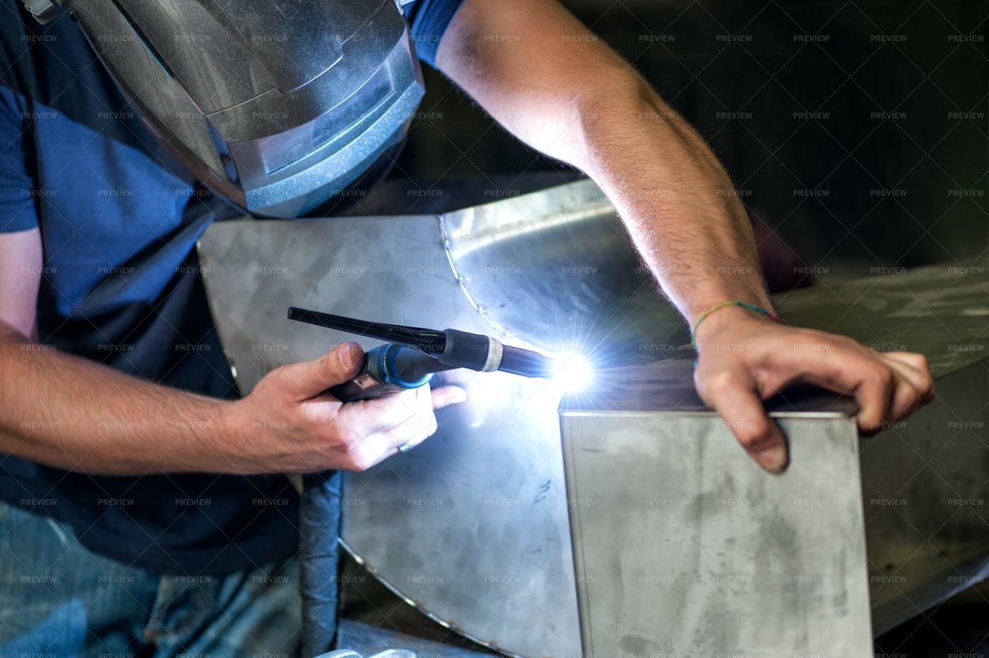 Welding Two Metal Components: Stock Photos