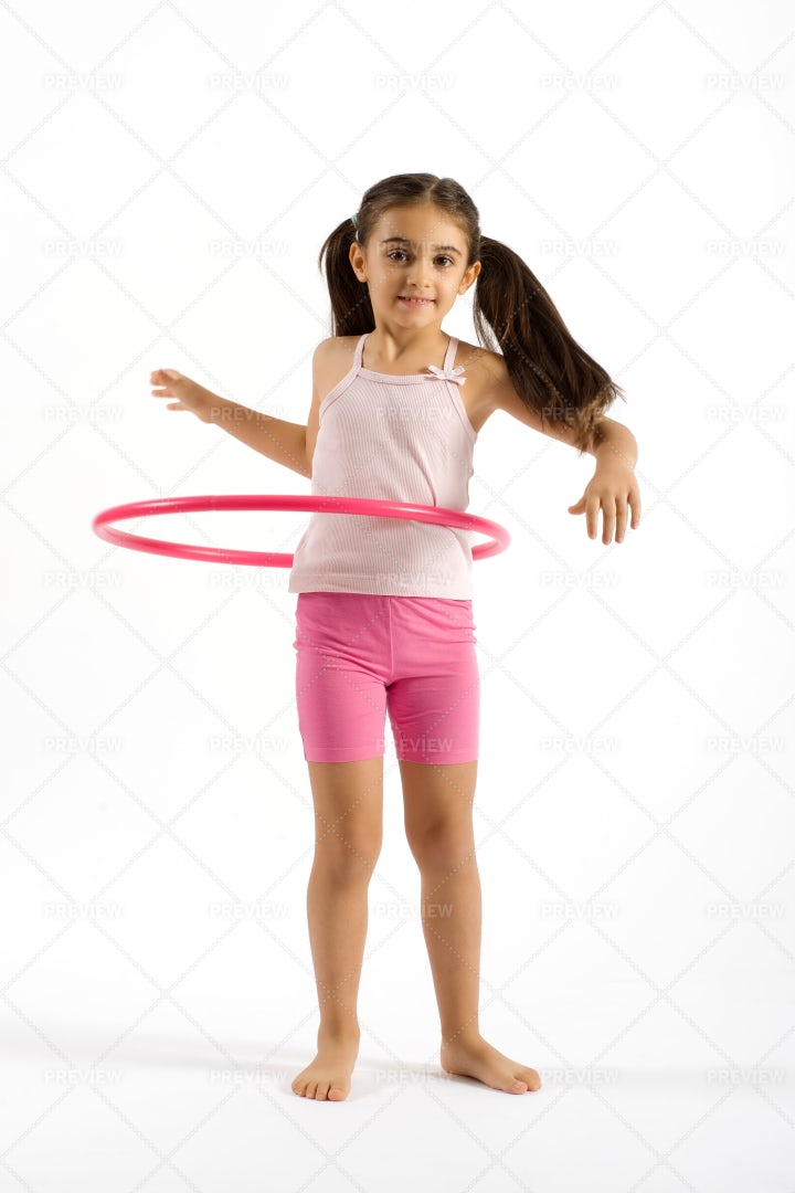 Girl Playing Hula Hoop: Stock Photos
