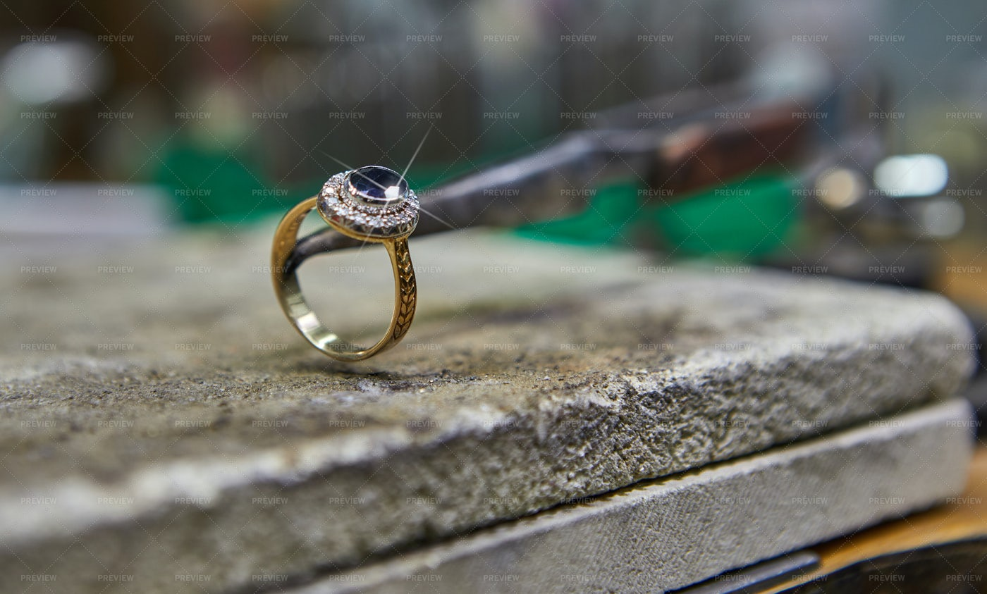 Jeweler With A Finished Ring: Stock Photos