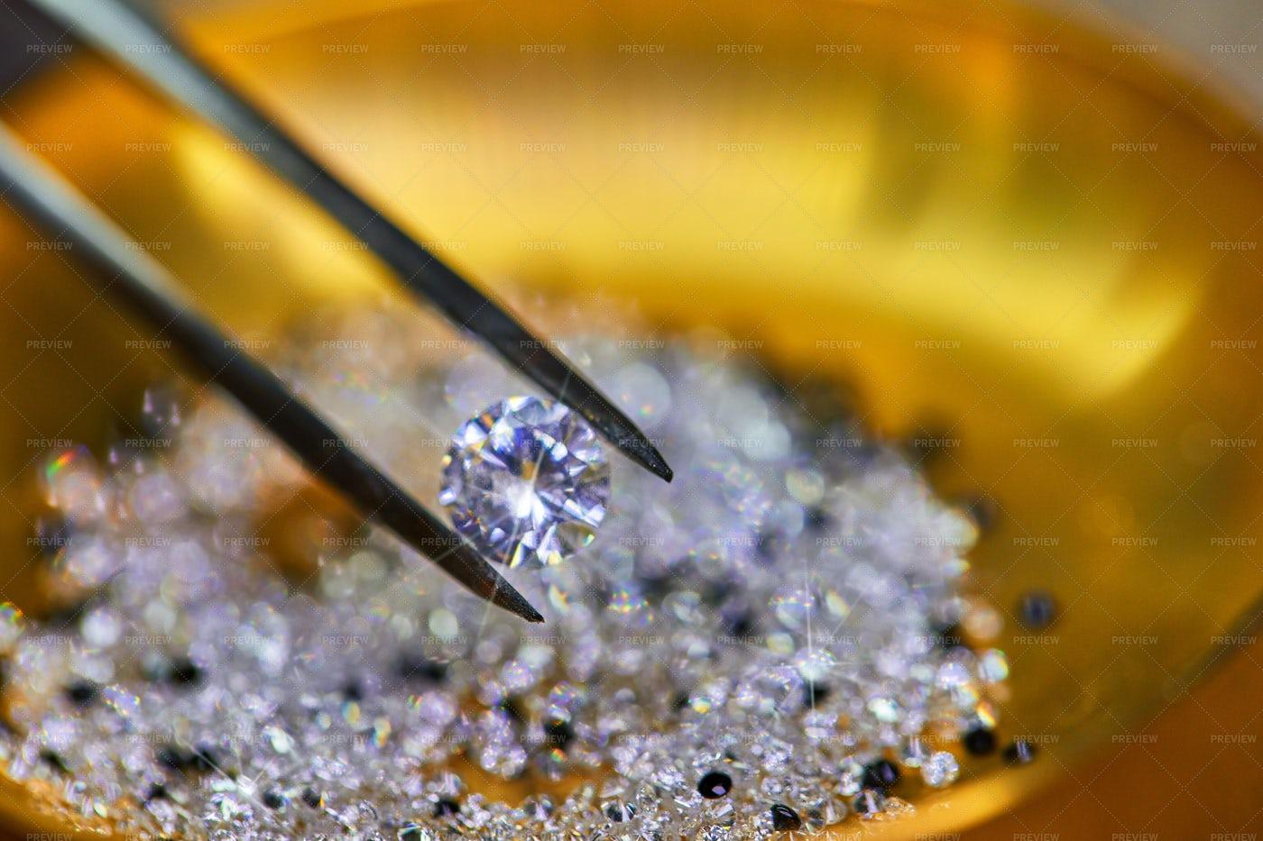 Diamond Held By Tweezers: Stock Photos