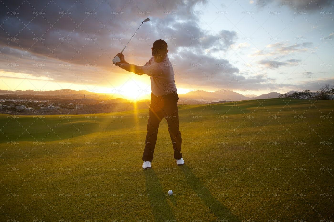 Golfer At Sunset: Stock Photos