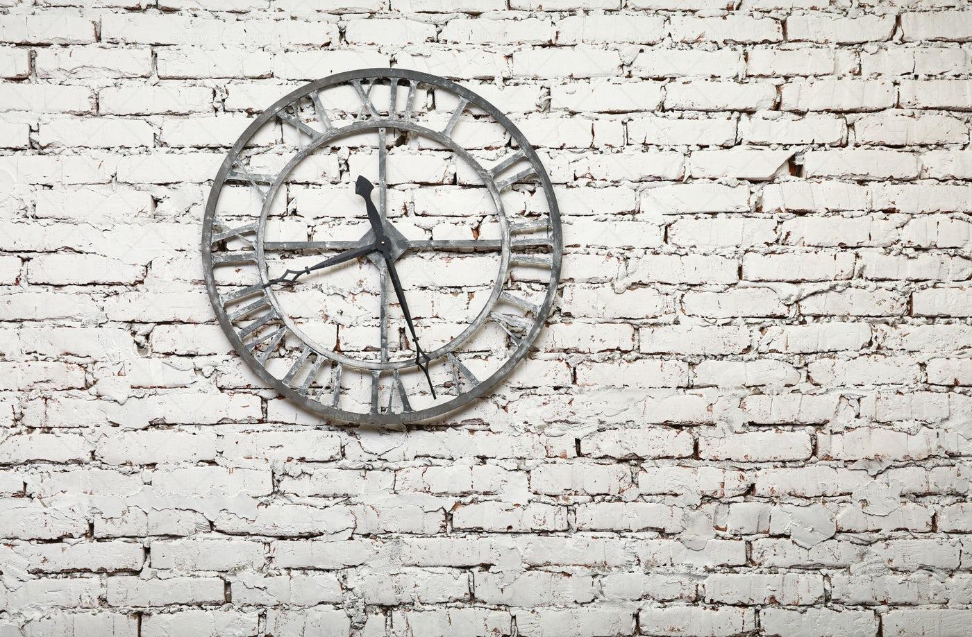 Metal Clock On Wall: Stock Photos