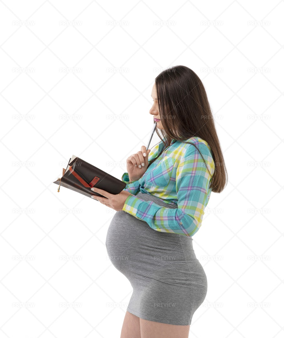 Pregnant Woman Checks Diary: Stock Photos