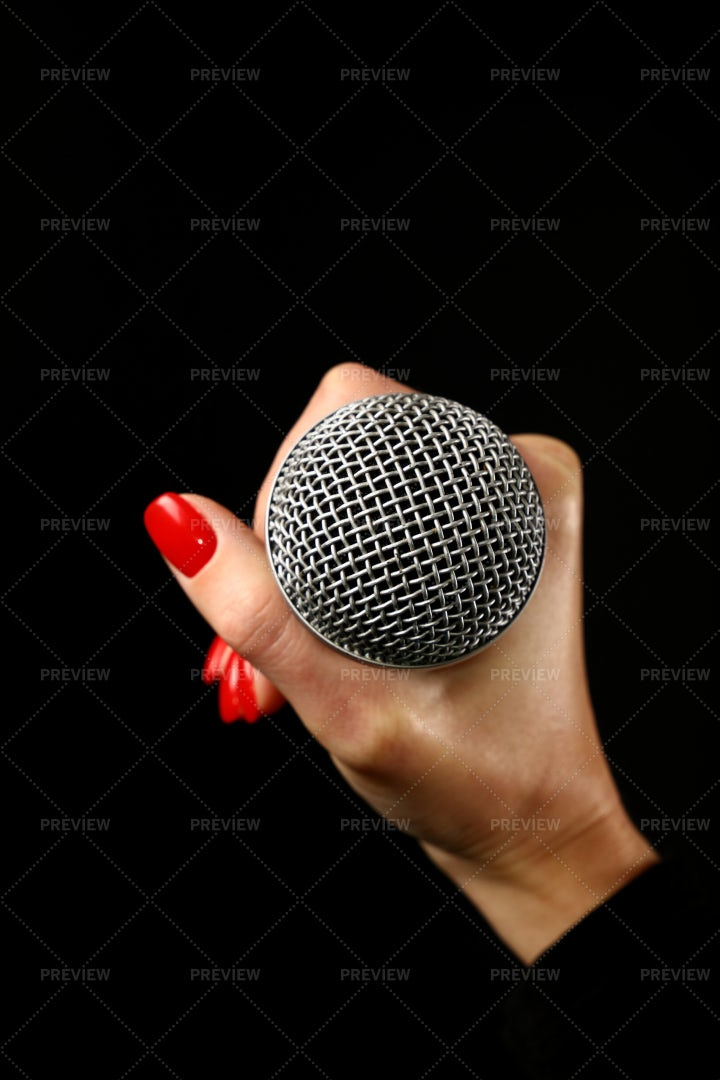 Holding A Microphone: Stock Photos