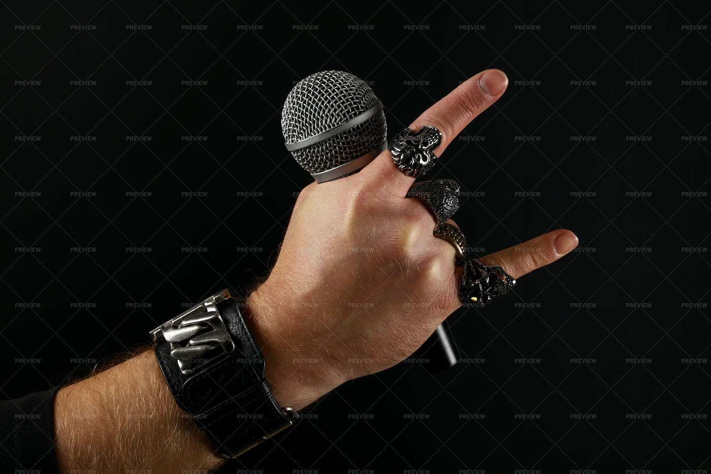 Rocker Hand With Microphone: Stock Photos