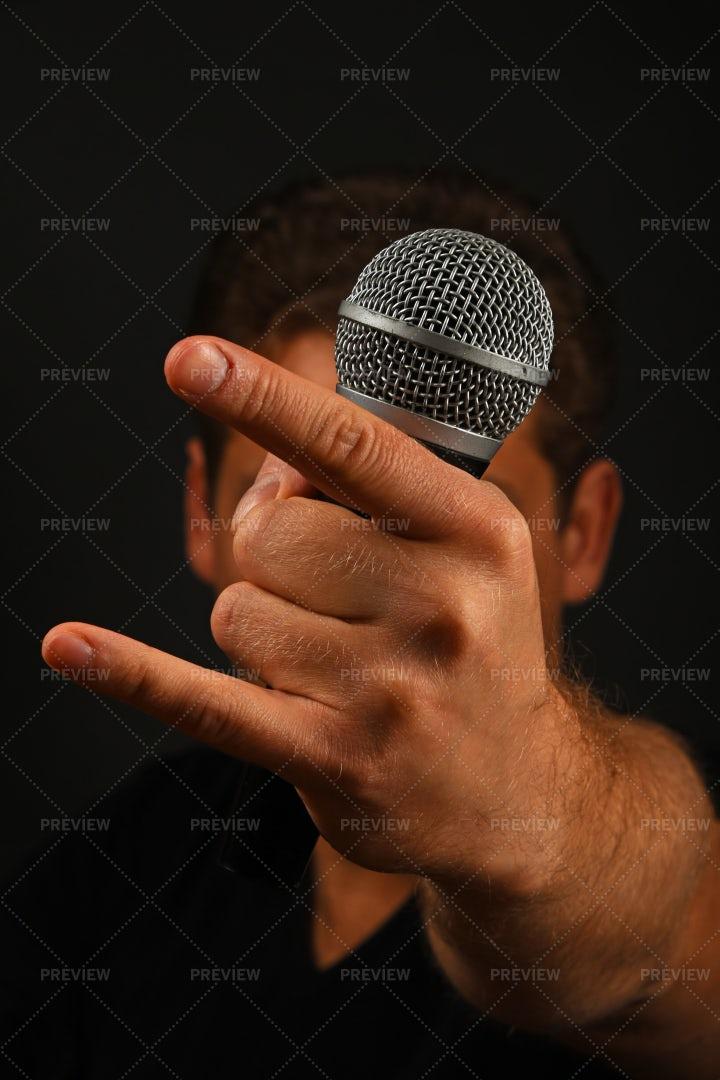 Metal Singer Throws Gesture: Stock Photos