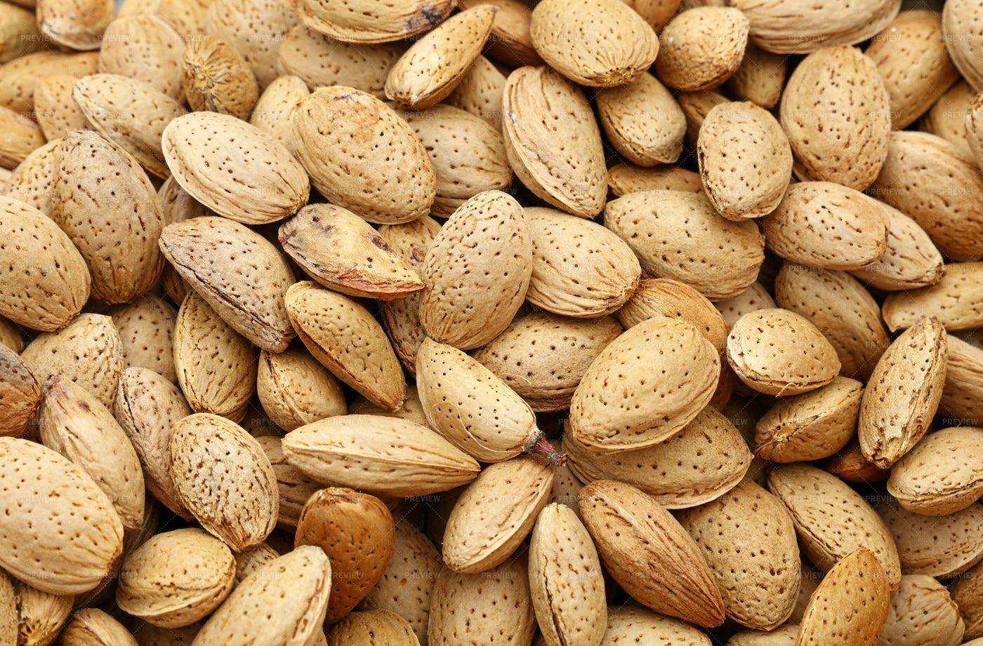 Almond Nuts In Nutshells: Stock Photos