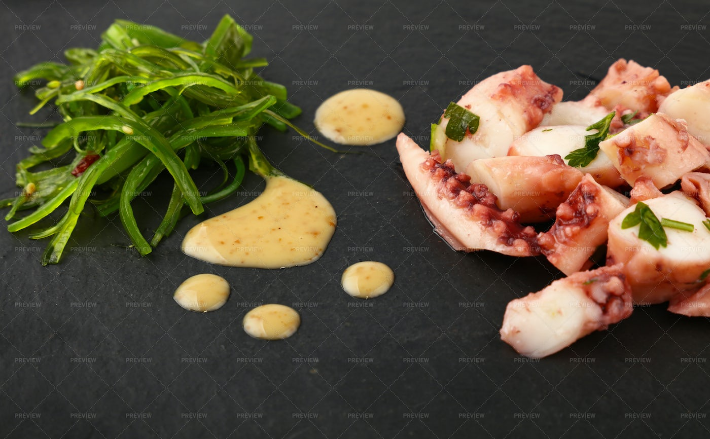Octopus Slices And Salad: Stock Photos
