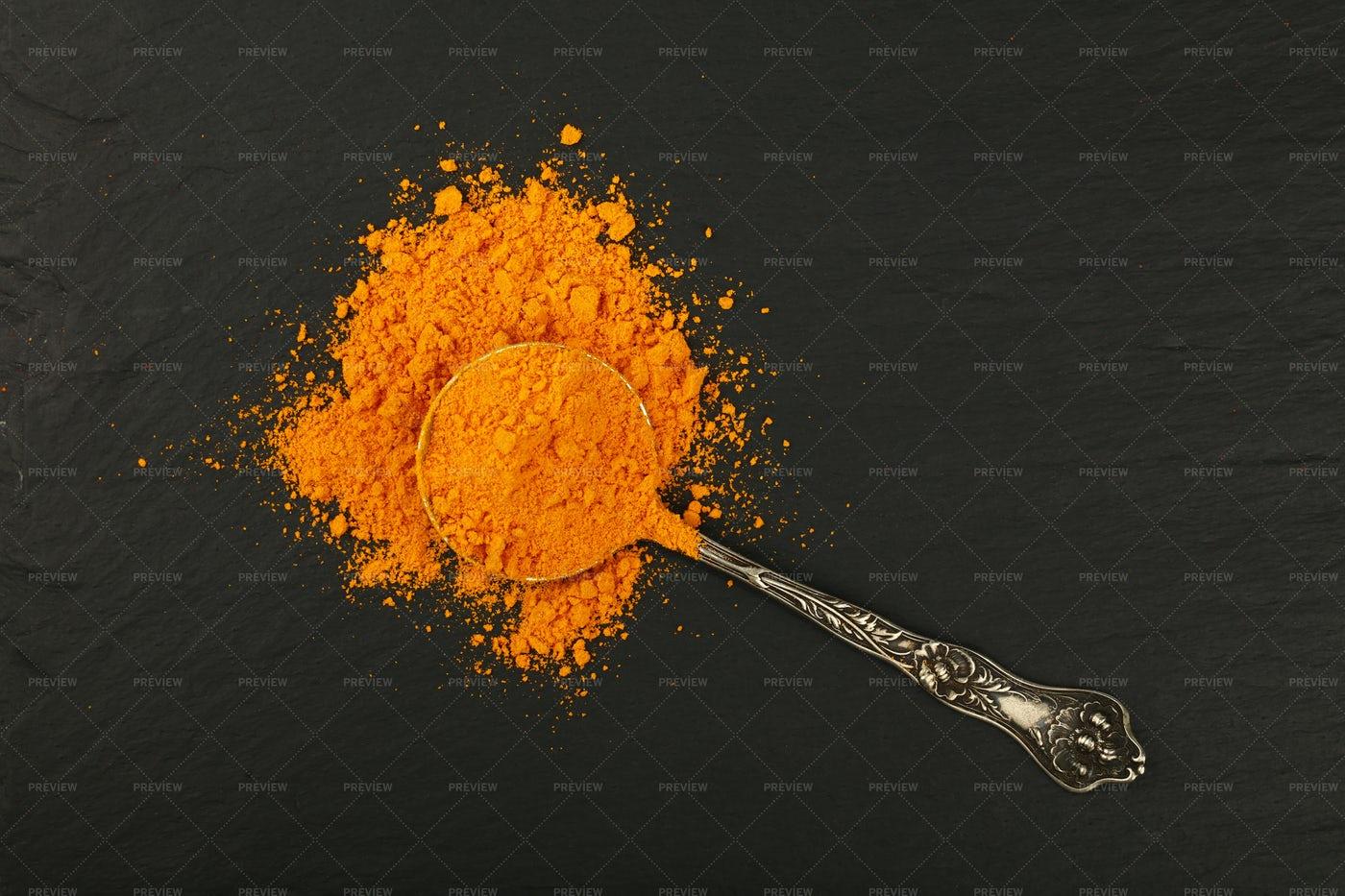 Spoon Of Turmeric Powder: Stock Photos