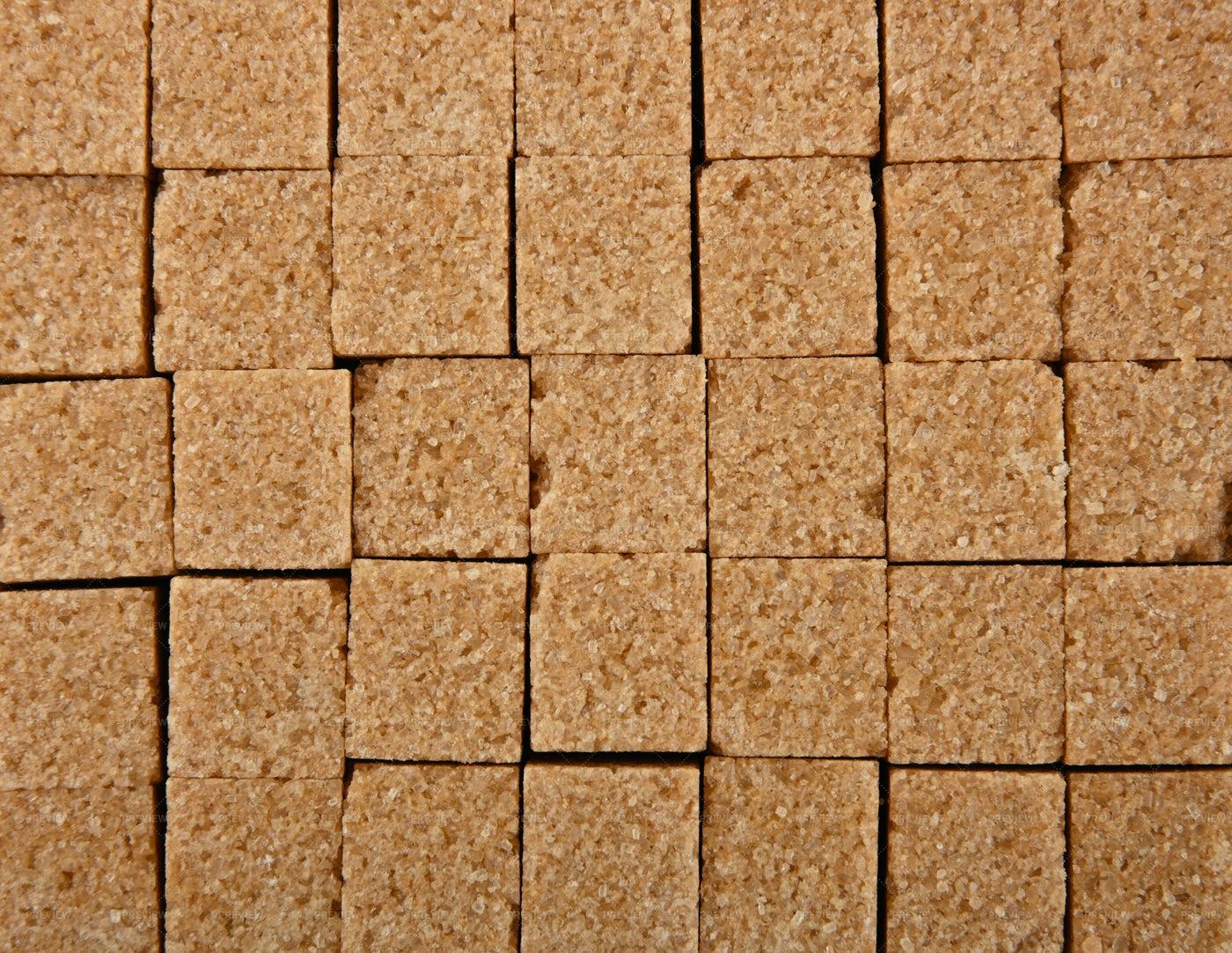 Brown Sugar Cube Background: Stock Photos