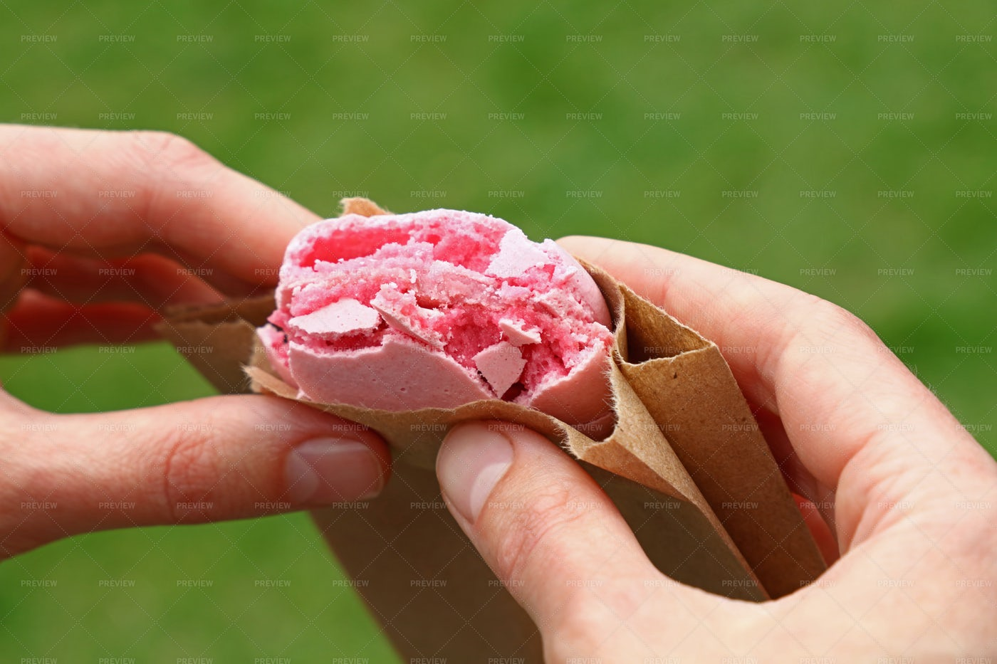 Eating Macaron Cookie: Stock Photos