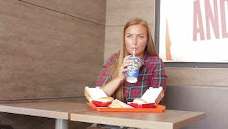 Woman Eating Fast Food: Stock Video
