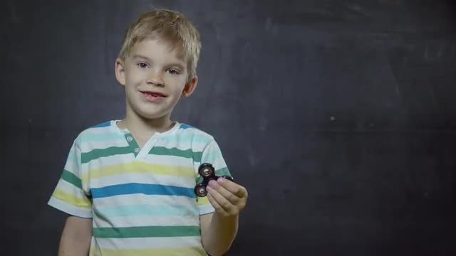Kid With Spinner : Stock Video