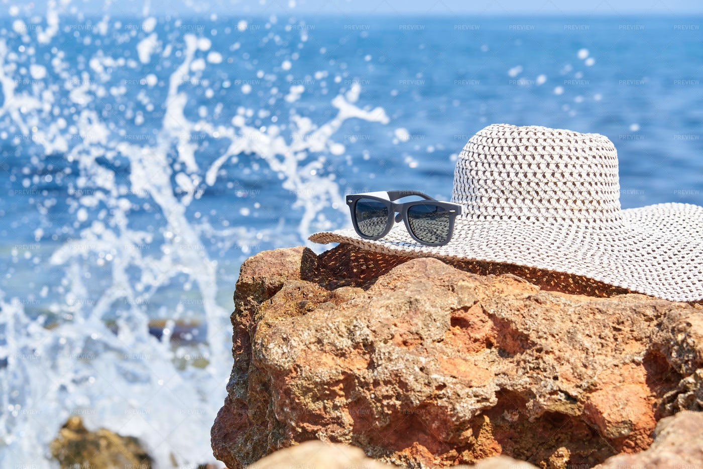 Hat And Sunglasses On The Beach: Stock Photos
