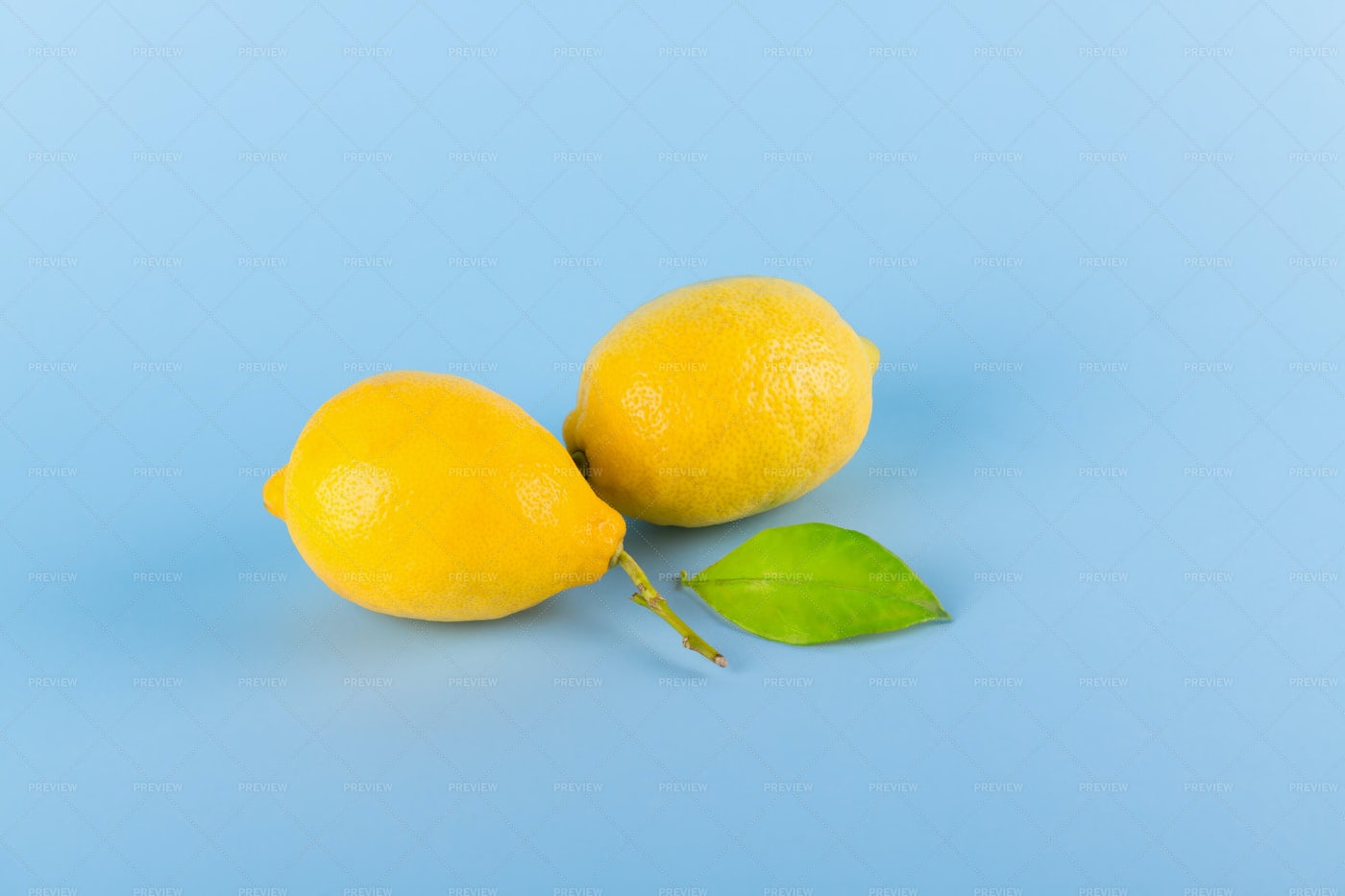 Two Fresh Yellow Lemons: Stock Photos