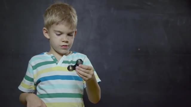 Kid With Spinner: Stock Video