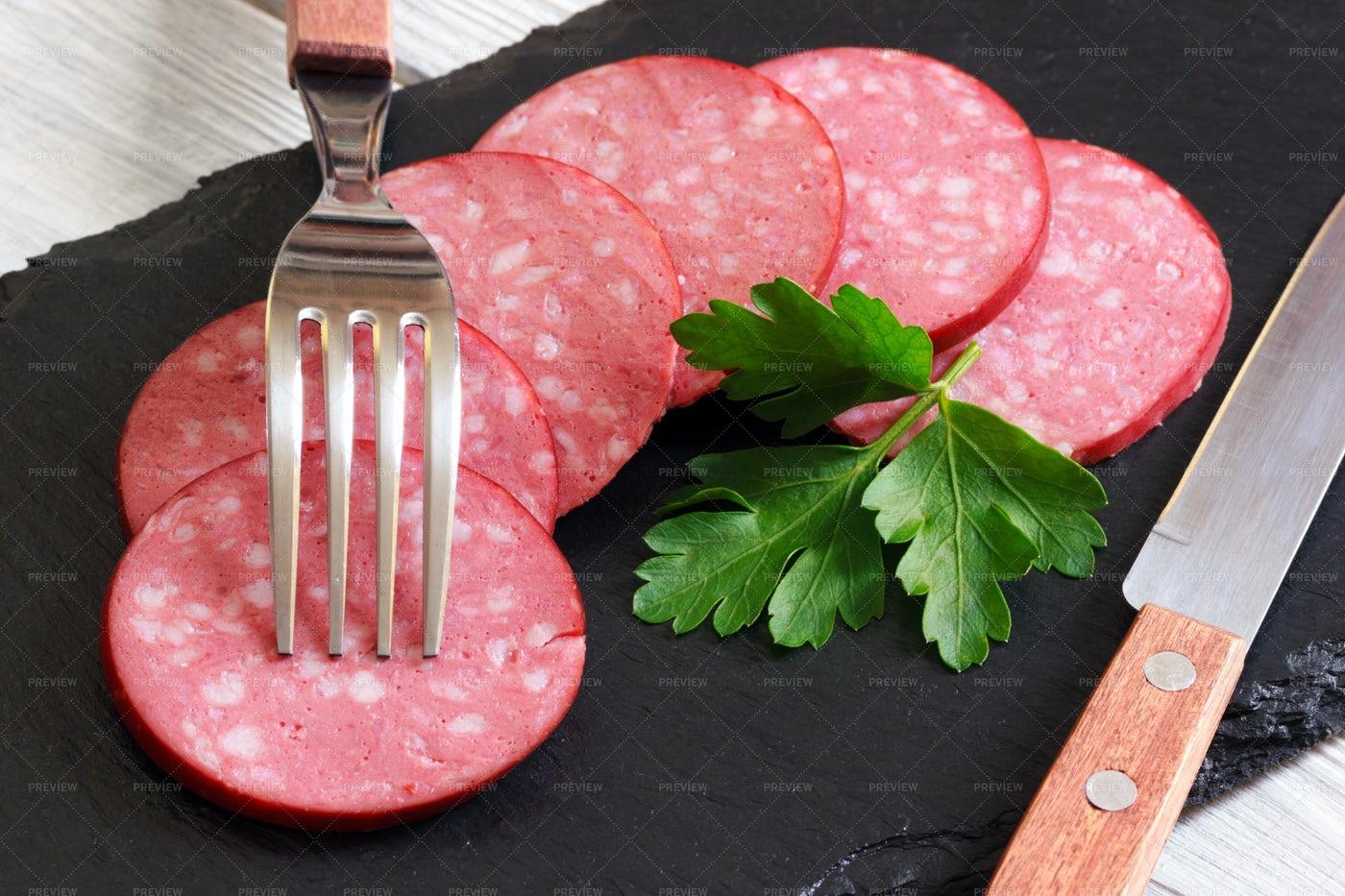 Sliced Smoked Sausage: Stock Photos
