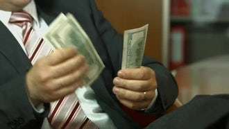 Businessman counting money: Stock Footage