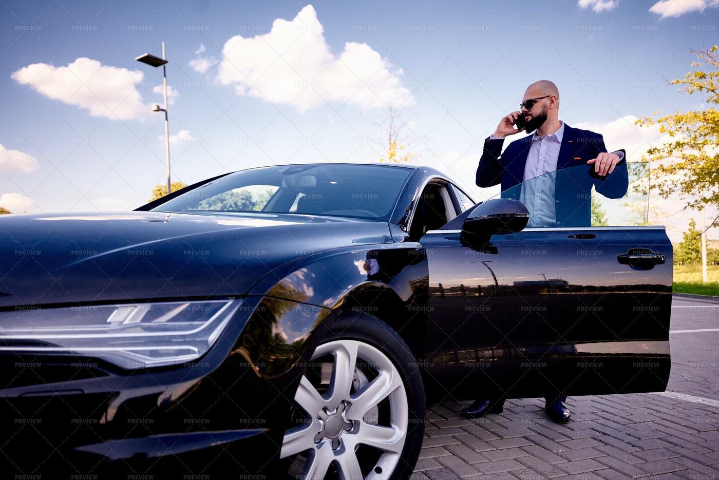 Businessman With Car: Stock Photos
