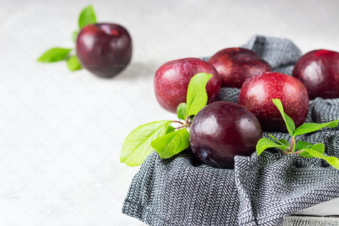 Purple Plums With Leaves: Stock Photos