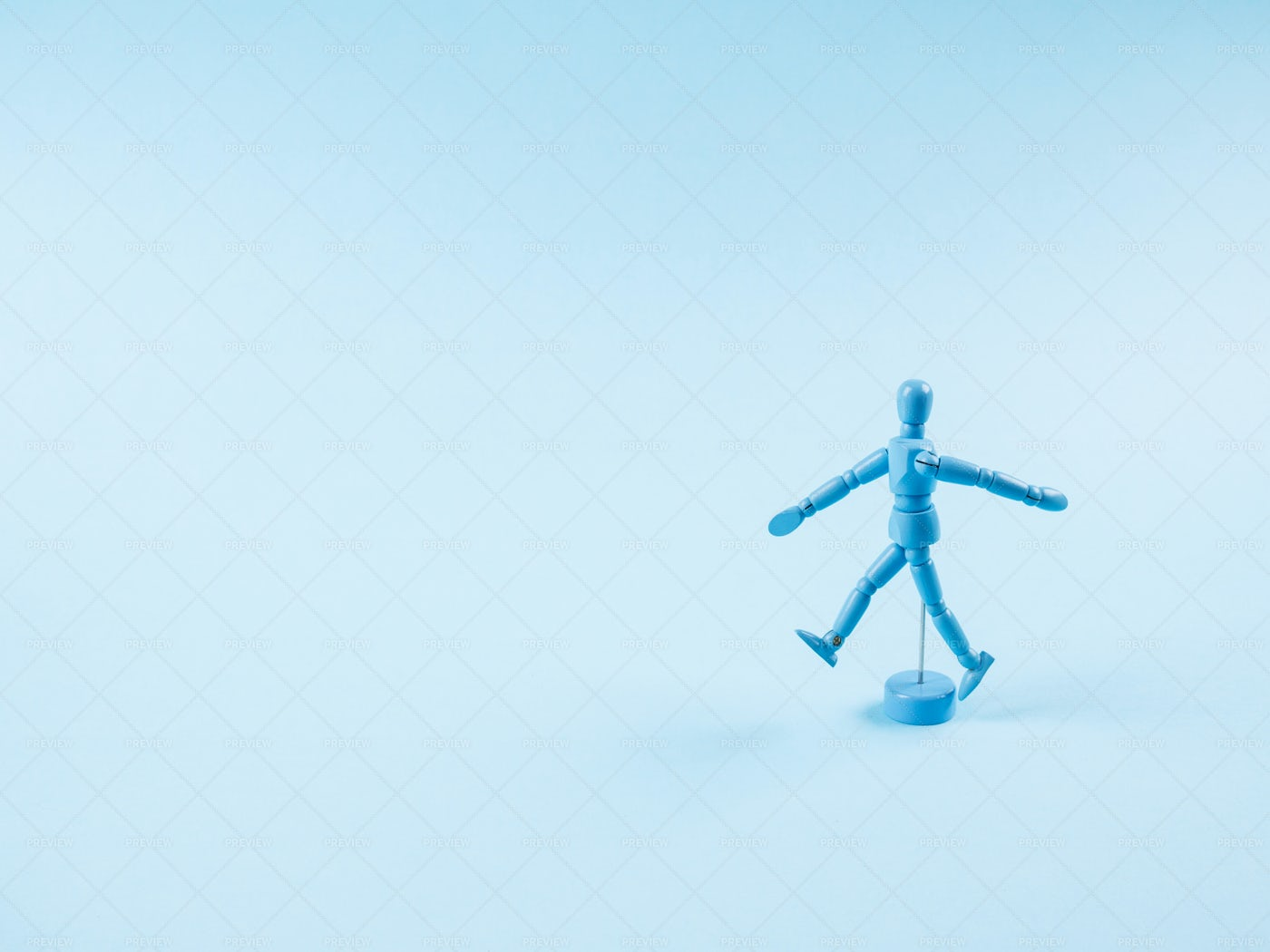 Walking Blue Marionette: Stock Photos
