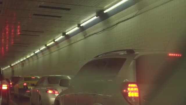 Slow Car Taillights Stuck in Traffic In Busy Tunnel: Stock Video
