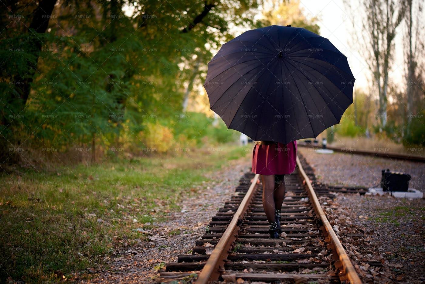 Woman With A Black Umbrella: Stock Photos