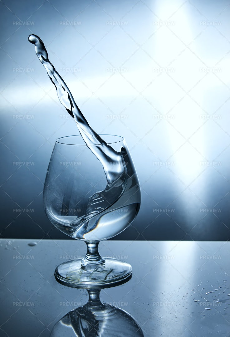 Splashing Water Into A Glass: Stock Photos