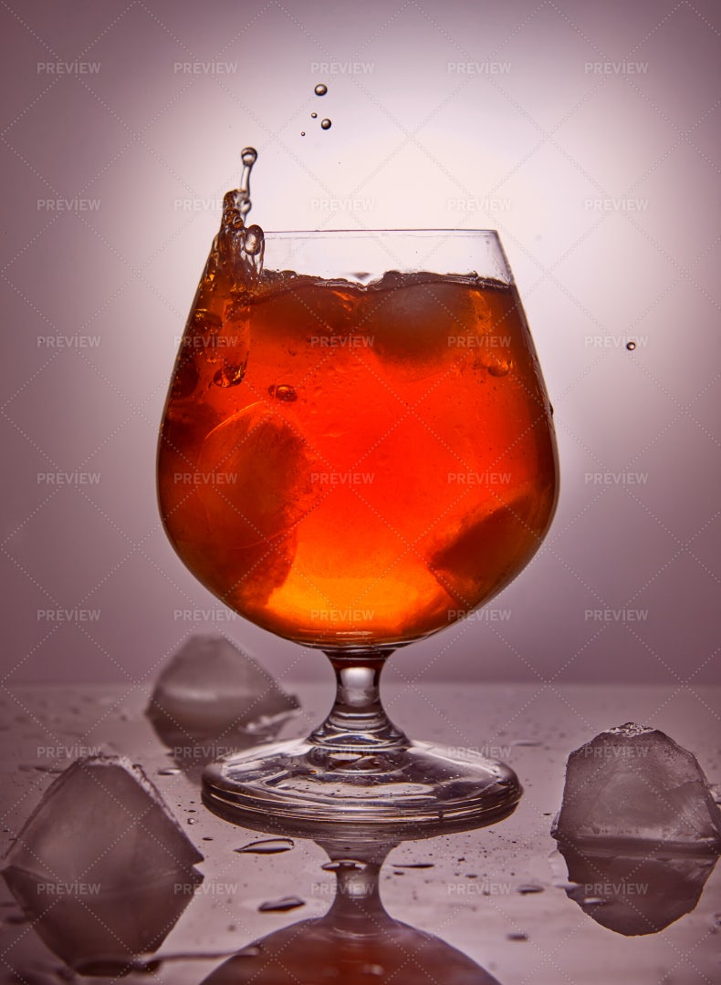 Dark Liquor With Ice: Stock Photos