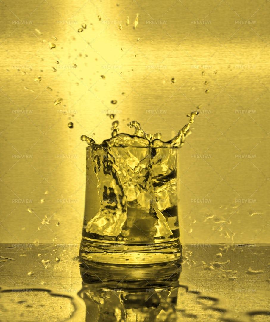 Cubes Splashing Into Water: Stock Photos