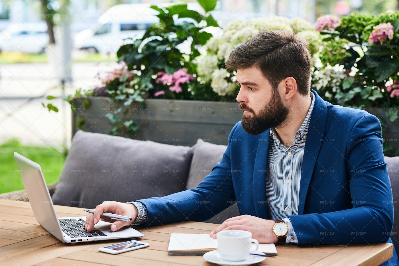 Bearded Businessman Working In Cafe...: Stock Photos